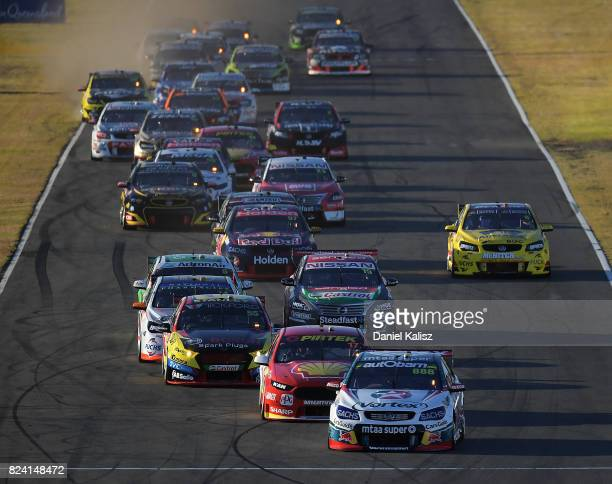 Craig Lowndes drives the TeamVortex Holden Commodore VF leads the field at the start of race 15 for the Ipswich SuperSprint which is part of the...