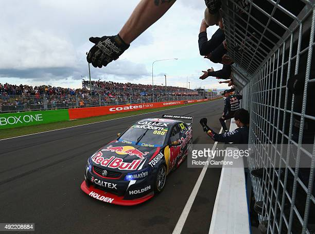 Craig Lowndes driving the Red Bull Racing Australia Holden crosses the line to win the Bathurst 1000 which is race 25 of the V8 Supercars...