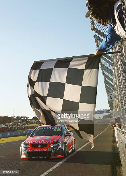 Craig Lowndes driving the Team Vodafone Holdencrosses the line to win the LH 500 race for round nine of the V8 Supercar Championship Series at...