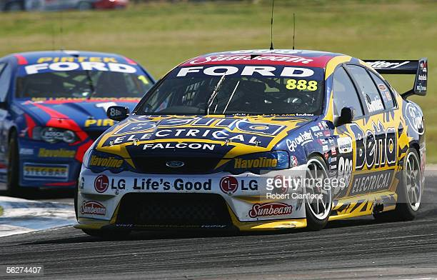Craig Lowndes of the Triple Eight Race Team leads Marcos Ambrose of the Stone Brothers Racing Team during the final round of the V8 Supercar...