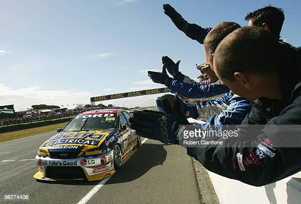 Craig Lowndes of the Triple Eight Race Team wins race one of the final round of the V8 Supercar Championship Series at the Phillip Island Grand Prix...