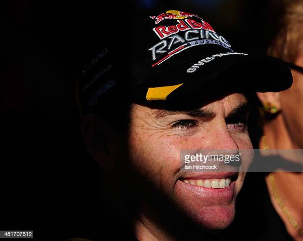 Craig Lowndes who drives the Red Bull Racing Australia Holden looks on during an autograph session before race 20 for the Townsville 500 which is...