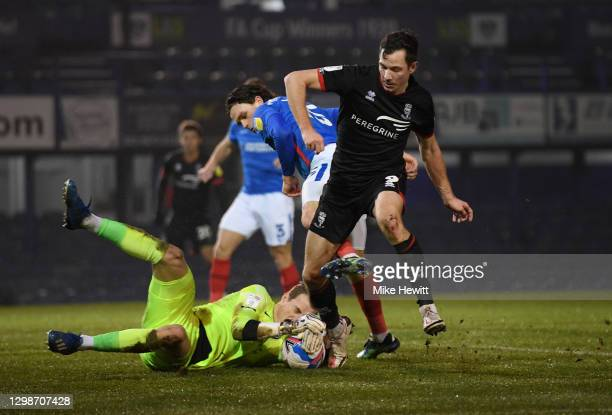 Craig MacGillivray of Portsmouth FC saves from Tom Hopper of Lincoln City during the Sky Bet League One match between Portsmouth and Lincoln City at...