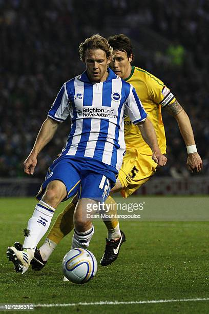 Craig MackailSmith of Brighton and Patrick McCarthy of Crystal Palace battle for the ball during the npower Championship match between Brighton and...