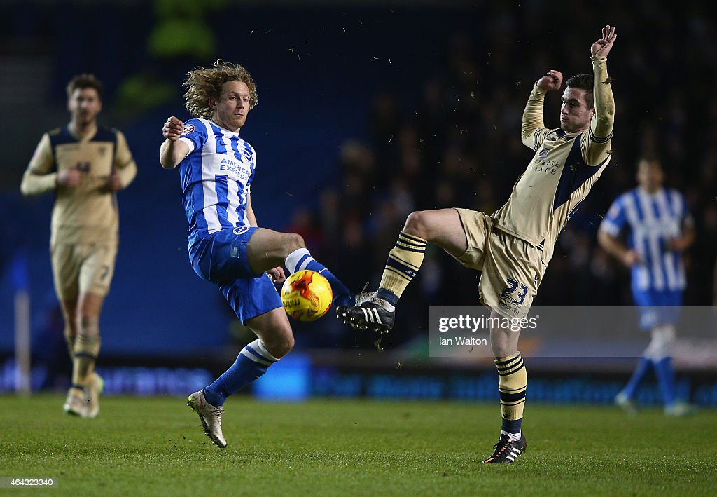 Craig Mackail-Smith of Brighton & Hove Albion and Lewis Cook of Leeds in action during the Sky Bet Championship match between Brighton & Hove Albion and Leeds United at Amex Stadium on February 24, 2015 in Brighton, England.