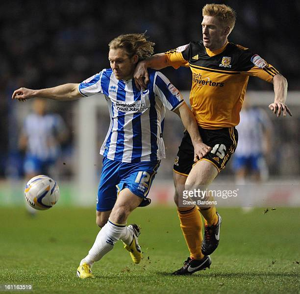 Craig MackailSmith of Brighton Hove Albion challenges for the ball with Paul McShane of Hull City during the npower Championship match between...