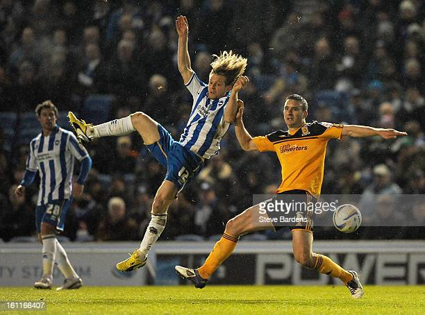 Craig MackailSmith of Brighton Hove Albion challenges for the ball with Jack Hobbs of Hull City during the npower Championship match between Brighton...