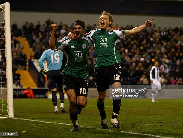 Craig Mackail-Smith of Peterborough celebrates scoring during the the FA Cup Sponsored by E.on third round match between West Bromwich Albion and...
