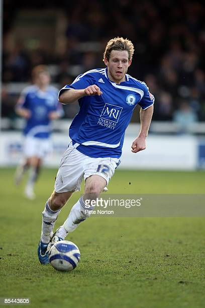 Craig MackailSmith of Peterborough United runs with the ball during the Coca Cola League One Match between Peterborough United and Northampton Town...