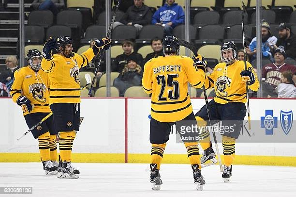Craig Martin of the Quinnipiac Bobcats celebrates his goal with Brogan Rafferty in the third period during game one of the Three Rivers Classic...