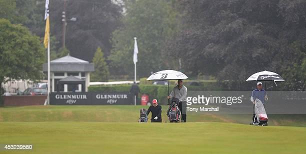 Craig Matheson of Falkirk Tryst Golf Club Jonathan Barnes of Oak Park Golf Club and Jason Groat of Denver Golf Club walk down the 1st fairway during...