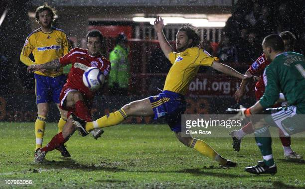 Craig McAllister of Crawley Town scores their first goal during the FA Cup sponsored by EON 3rd round match between Crawley Town and Derby County at...