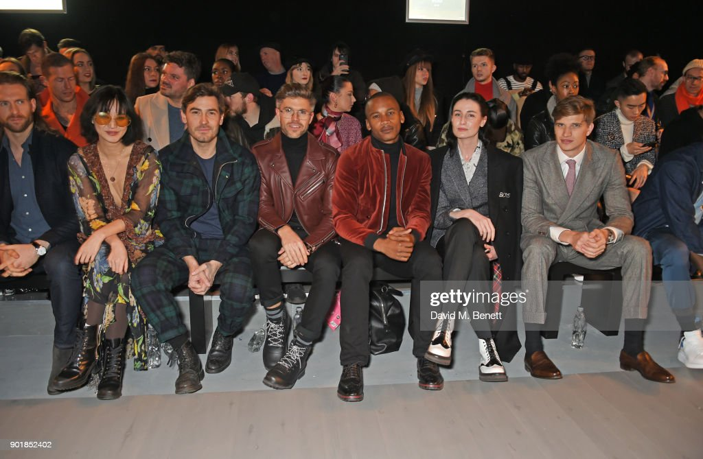 Craig McGinlay, Betty Bachz, Robert Konjic, Darren Kennedy, Eric Underwood, Erin OÕConnor, Toby Huntington-Whiteley sit in the front row at the Oliver Spencer LFWM AW18 Catwalk Show at the BFC Show Space on January 6, 2018 in London, England.