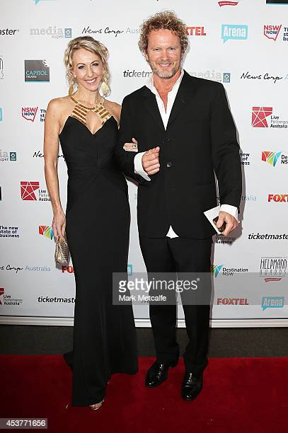 Craig McLachlan and partner arrive at the 2014 Helpmann Awards at the Capitol Theatre on August 18 2014 in Sydney Australia