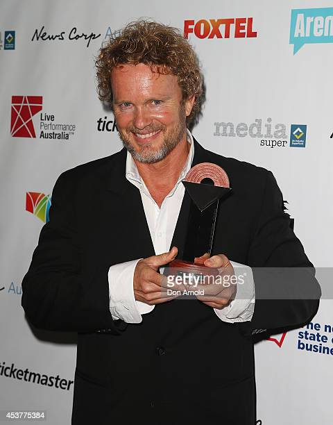 Craig McLachlan poses with the award for Best Actor in a Musical at the Capitol Theatre on August 18 2014 in Sydney Australia