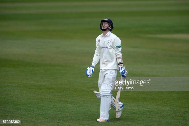 Craig Miles of Gloucestershire walks off after being dismissed during the Specsavers County Championship Division Two match between Gloucestershire...