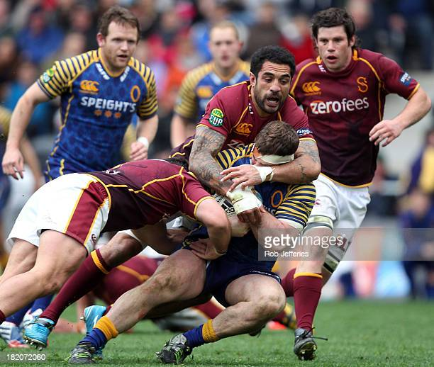 Craig Millar of Otago is hit hard by the Southland defence of Hale TPole during the round seven ITM Cup match between Otago and Southland at Forsyth...