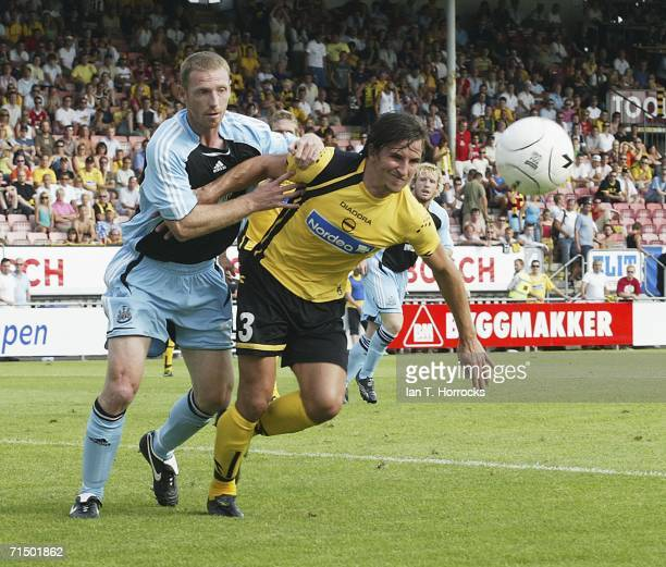 Craig Moore of Newcastle clashes with Shane Stefanutto of Lillestrom SK during the UEFA Intertoto Cup third round Second leg match between Lillestrom...