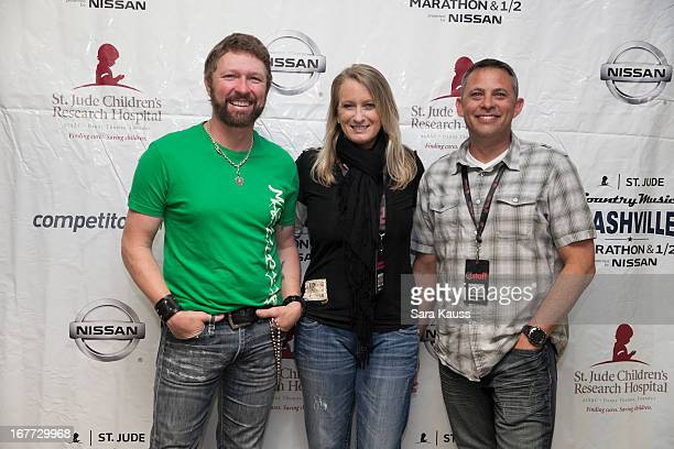 Craig Morgan Kim Dettwiller Burton and Gordon Burton attend the St Jude Country Music Marathon and Half Marathon Post Race Concert presented by...