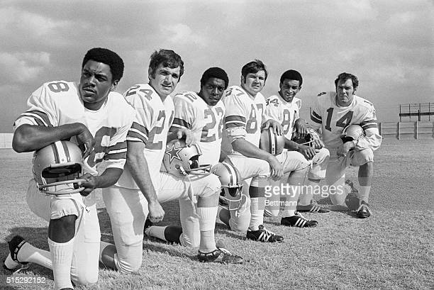Craig Morton far right looks over his receivers Reggie Rucker Dennis Homan Bob Hayes Mike Ditka and Pettis Norman The Cowboys are preparing to meet...