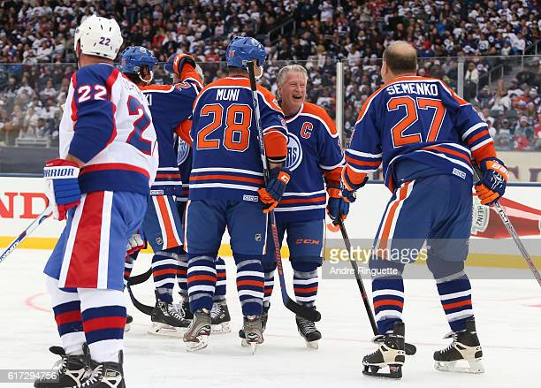 Craig Muni and Dave Semenko of the Edmonton Oilers alumni celebrate after a goal on Winnipeg Jets alumni during the 2016 Tim Hortons NHL Heritage...