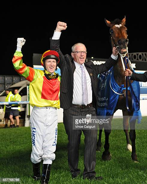 Craig Newitt and Trainer Mick Price celebrate after Lankan Rupee won Race 7 the Sportingbet Manikato Stakes during Manikato Stakes Night at Moonee...