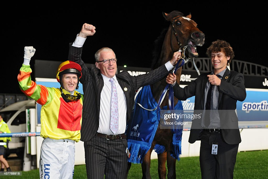 Craig Newitt and Trainer Mick Price celebrate after Lankan Rupee won Race 7, the Sportingbet Manikato Stakes during Manikato Stakes Night at Moonee Valley Racecourse on October 24, 2014 in Melbourne, Australia.