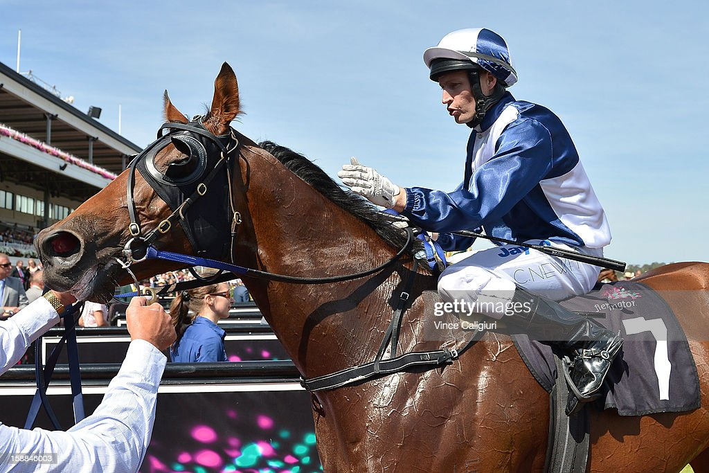 Craig Newitt riding Adamantium reacts after winning the Standish Handicap during Melbourne Racing at Flemington Racecourse on January 1, 2013 in Melbourne, Australia.