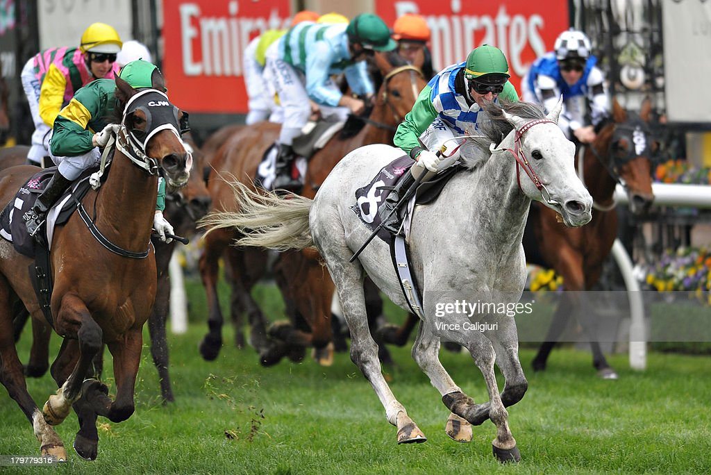 Craig Newitt riding Foreteller (L) defeats Glen Boss riding Puissance de Lune in the Makybe Diva Stakes during Melbourne racing at Flemington Racecourse on September 7, 2013 in Melbourne, Australia.