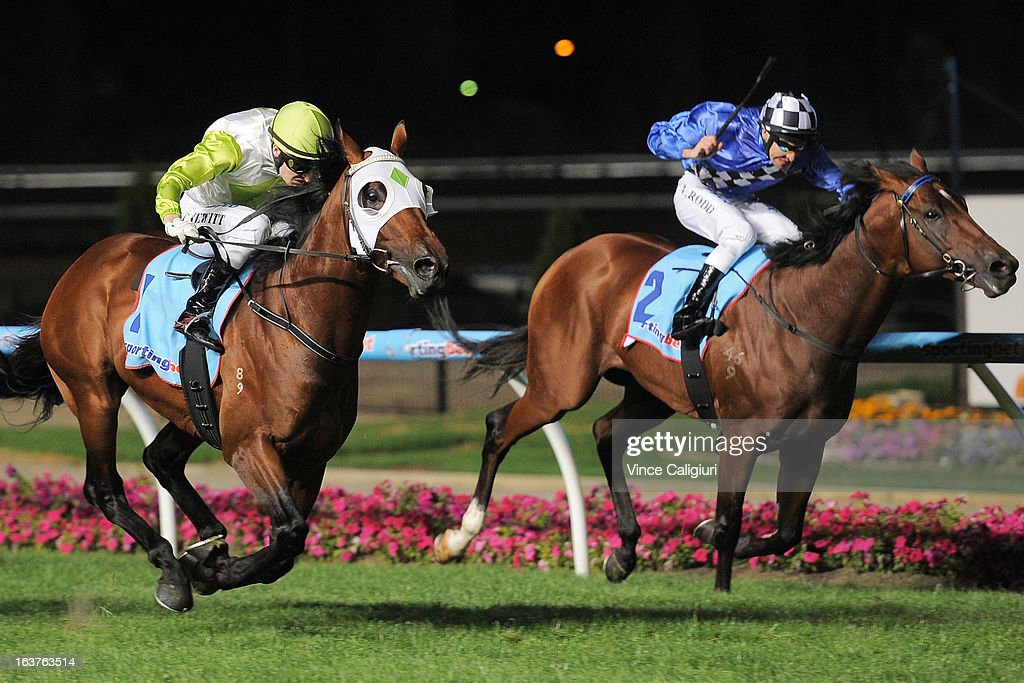 Craig Newitt riding Hvasstan (L) defeats Michael Rodd riding Sheer Talent in the Sportingbet Alister Clark Stakes during Melbourne racing at Moonee Valley Racecourse on March 15, 2013 in Melbourne, Australia.