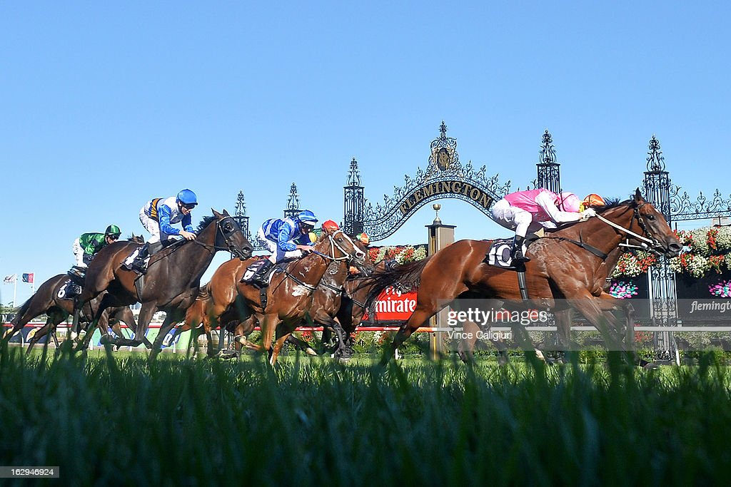 Craig Newitt riding Isabella Snowflake wins the ATA/Bob Hoysted Handicap during Melbourne Racing at Flemington Racecourse on March 2, 2013 in Melbourne, Australia.