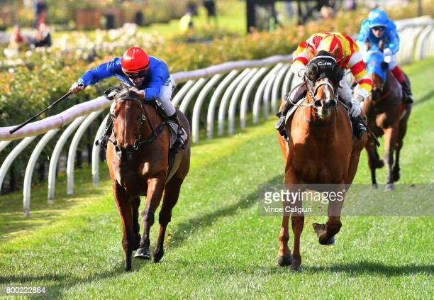 Craig Newitt riding Overstep defeats Beau Mertens riding Invincible Al in Race 2 during Melbourne Racing at Flemington Racecourse on June 24 2017 in...