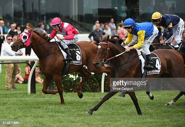 Craig Newitt riding The Quarterback defeats Damian Lane riding Black Heart Bart in Race 6 Lexus Newmarket Handicap during Melbourne Racing at...