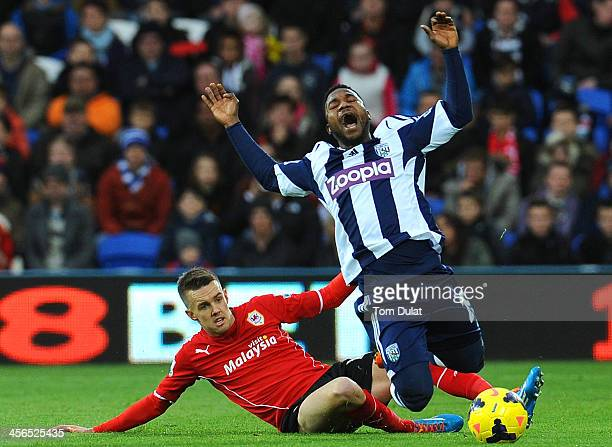 Craig Noone of Cardiff City and Stephane Sessegnon of West Bromwich Albion in action during the Barclays Premier League match between Cardiff City...