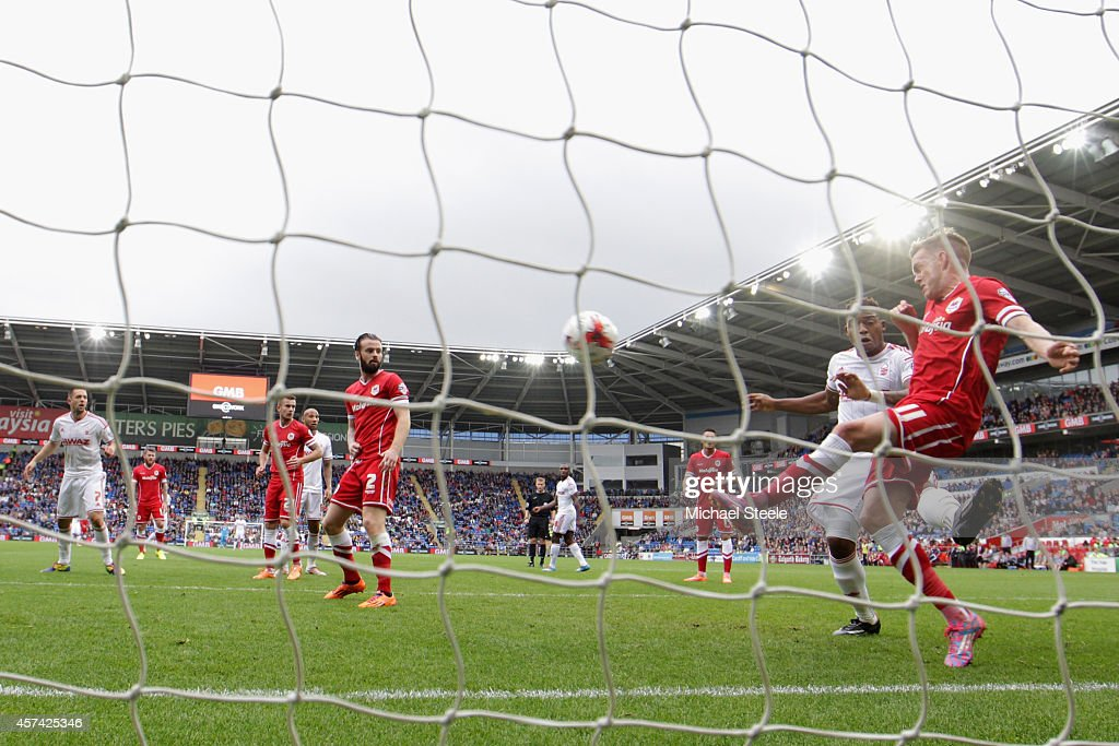Craig Noone (R) of Cardiff City clears a shot from Chris Burke of Nottingham Forest (out of frame) off the line during the Sky Bet Championship match between Cardiff City and Nottingham Forest at Cardiff City Stadium on October 18, 2014 in Cardiff, Wales.