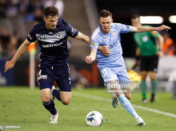 Craig Noone of Melbourne City and James Donachie of the Victory contest the ball during the round one A-League match between the Melbourne Victory...
