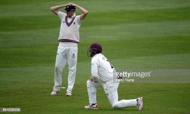 Craig Overton and Marcus Trescothick of Somerset react during Day Two of the Specsavers County Championship Division One match between Somerset and...