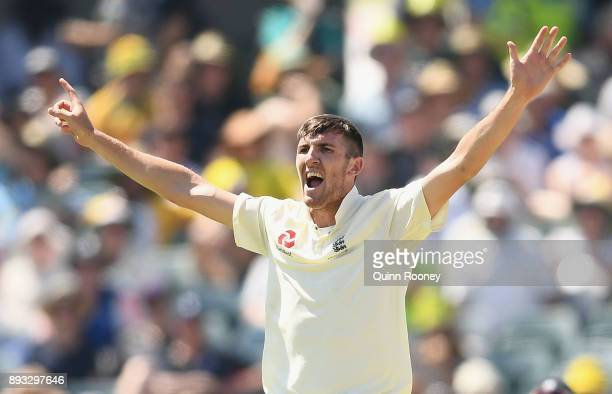 Craig Overton of England celebrates getting the wicket of Cameron Bancroft of Australia during day two of the Third Test match during the 2017/18...