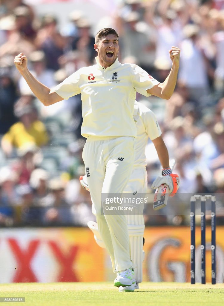 Craig Overton of England celebrates getting the wicket of David Warner of Australia during day two of the Third Test match during the 2017/18 Ashes Series between Australia and England at WACA on December 15, 2017 in Perth, Australia.
