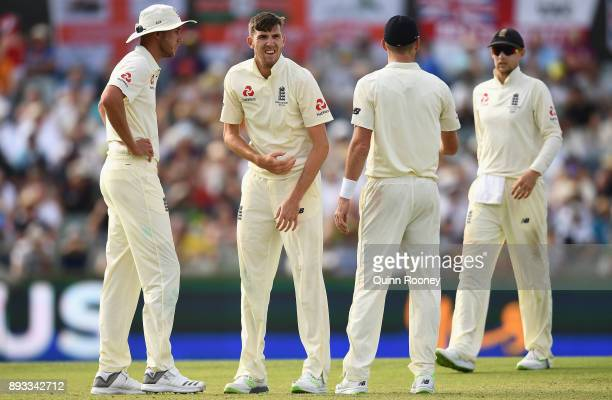 Craig Overton of England grimaces after injuring his side during day two of the Third Test match during the 2017/18 Ashes Series between Australia...