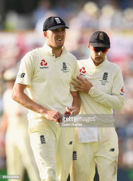 Craig Overton of England is consoled by Joe Root after injuring his side during day two of the Third Test match during the 2017/18 Ashes Series...
