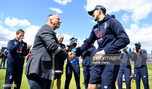 Craig Overton of England is presented his cap by Sir Ian Botham ahead of the 4th Royal London One Day International between England and Australia at...