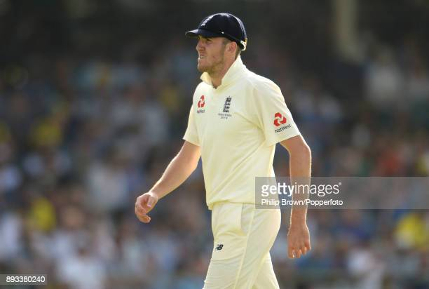 Craig Overton of England leaves the field during the second day of the third Ashes cricket test match between Australia and England at the WACA on...