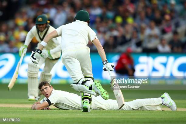 Craig Overton of England looks at Steve Smith of Australia as he runs between the wickets during day one of the Second Test match during the 2017/18...