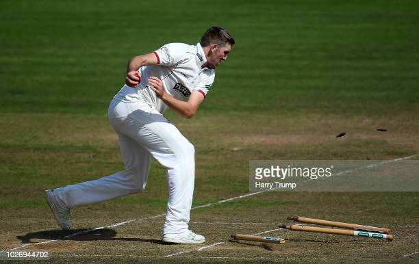 Craig Overton of Somerset attempts a run out by knocking out all three stumps during Day Two of the Specsavers County Championship Division One match...