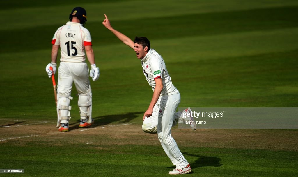 Craig Overton of Somerset(R) celebrates after dismissing Steven Croft of Lancashire during Day Two of the Specsavers County Championship Division One match between Somerset and Lancashire at The Cooper Associates County Ground on September 13, 2017 in Taunton, England.