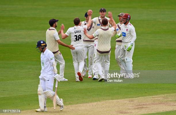 Craig Overton of Somerset celebrates after taking a catch to dismiss Felix Organ of Hampshire off the bowling of Josh Davey of Somerset during day...