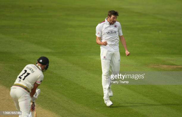 Craig Overton of Somerset celebrates after taking the wicket of George Hankins of Gloucestershire during Day Three of the Bob Willis Trophy match...