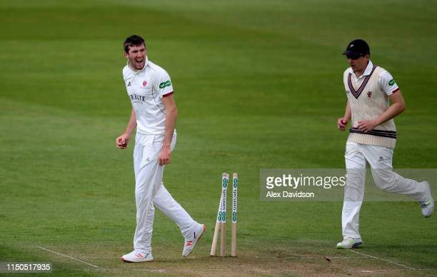 Craig Overton of Somerset celebrates the run out of Will Rhodes of Warwickshire during Day One of the Specsavers County Championship match between...