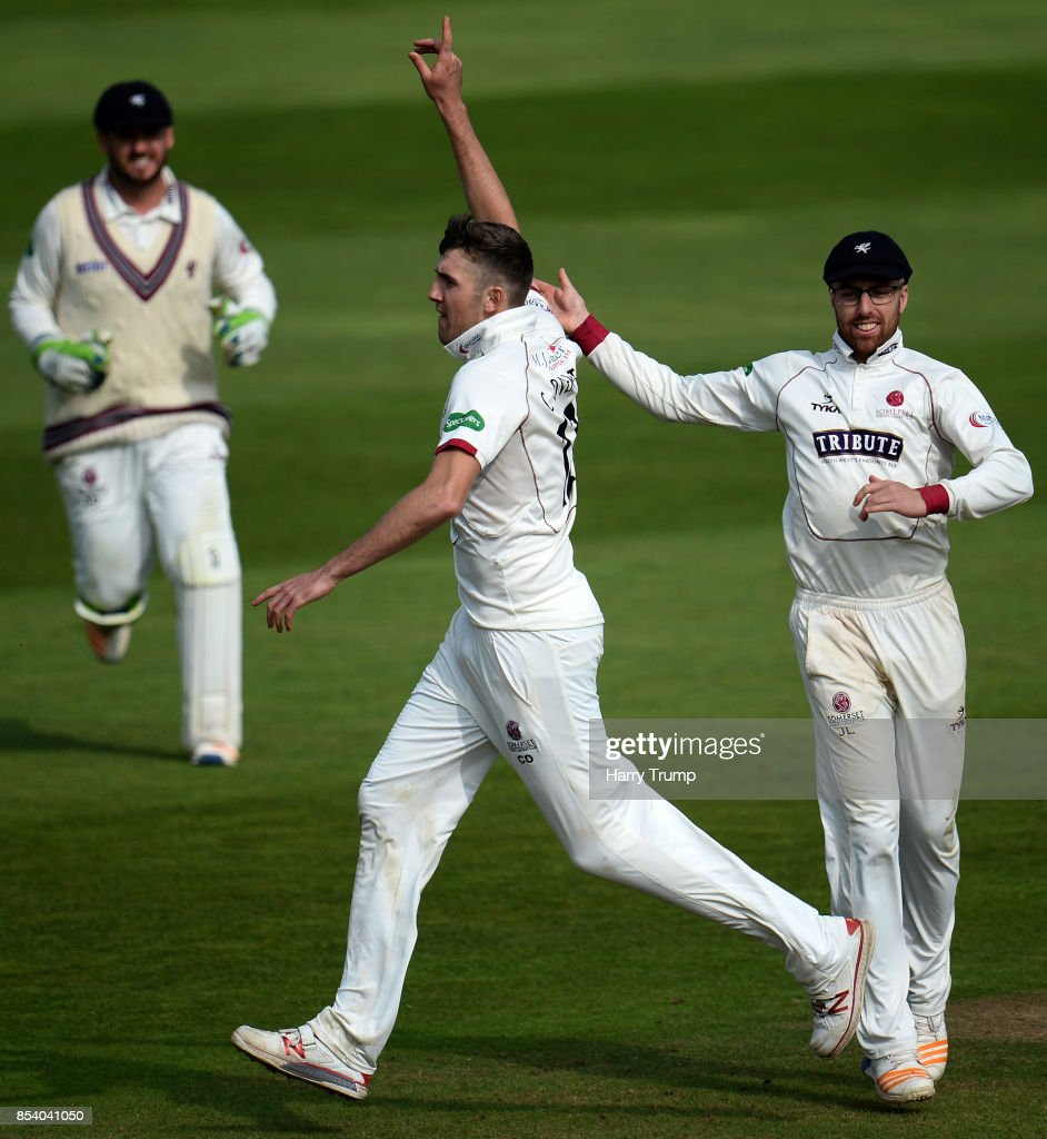 Craig Overton of Somerset(C) celebrates the wicket of James Harris of Middlesex during Day Two of the Specsavers County Championship Division One match between Somerset and Middlesex at The Cooper Associates County Ground on September 26, 2017 in Taunton, England.
